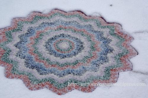 plastmatta i snö